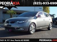 This is a 2013 Kia Forte with a gray exterior color and