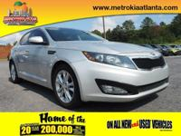 This 2013 Kia Optima EX is complete with top-features
