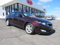 Optima EX Premium and Black w/Nappa Leather Seat Trim.