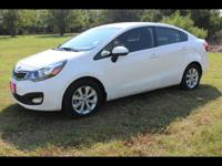 You can't go wrong with this WHITE 2013 Kia Rio.  It