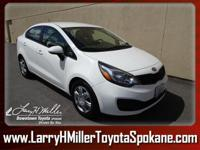 Check out this versatile 2013 Kia Rio LX. Woven Cloth