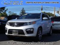 This 2013 Kia Sorento SX boasts features like a backup
