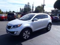 This 2013 Kia Sportage EX is complete with top-features