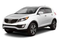 This 2013 Kia Sportage SX boasts features like dual