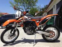This is a 2013 KTM 450 XC-W dual sport that has been