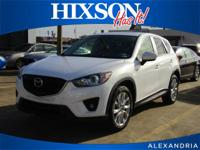 This outstanding example of a 2013 Mazda CX-5 Grand
