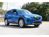 This 2013 Mazda CX-5 Grand Touring is offered to you