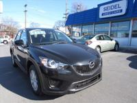 This 2013 Mazda CX-5 Sport is just the great preowned