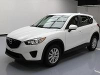 This awesome 2013 Mazda CX-5 comes loaded with the