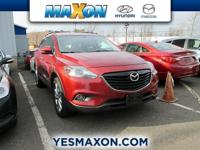 This outstanding example of a 2013 Mazda CX-9 Grand