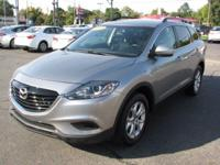 This 2013 Mazda CX-9 is available in Sport trim.