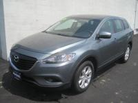 This outstanding example of a 2013 Mazda CX-9 Sport AWD