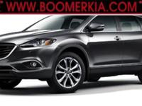 CX-9 Touring trim. FUEL EFFICIENT 24 MPG Hwy/17 MPG