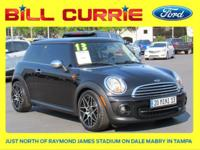Clean CARFAX. This 2013 MINI Cooper in Absolute Black