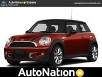 Rush in and see this RED MINI before it is gone to the