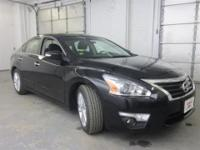 Elegant in Ebony, this pre-owned 2013 Nissan Altima is