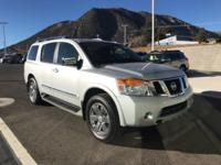 The 2013 Nissan Armada 4wd Platinum commands the road.