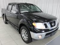 This outstanding example of a 2013 Nissan Frontier SL