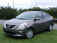 This outstanding example of a 2013 Nissan Versa SL is