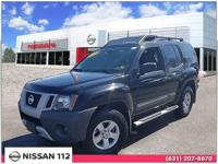This 2013 Nissan Xterra S has an exterior color of