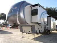 A 37' Fifth Wheel with 3 slide-outs and power leveling