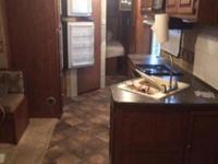 Good used travel trailer: 2013 Passport 3180RE for