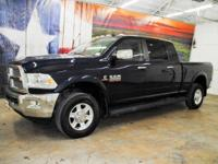 *Rule the roads in this true blue pearl 2013 Ram 2500