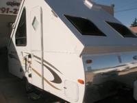 Features: 12' Pop Up Trailer, Air Conditioned and