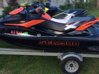 Up for bid is (2) jet skis with double trailer. These