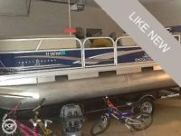 This is a well cared for 2013 Sun Tracker Pontoon Boat.