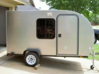 Teardrop style camper in brand-new condition. Fits in
