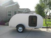 For Sale is a 2013 very customized Teardrop Trailer.