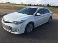 We are excited to offer this 2013 Toyota Avalon Hybrid.