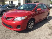 2013 Toyota Corolla LE Automatic with 27,621 Miles. Red