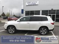 This Toyota Highlander is a beautiful pearl white with