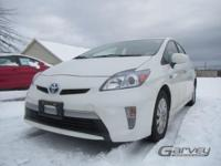 This 2013 Toyota Prius is a four-door hatchback with