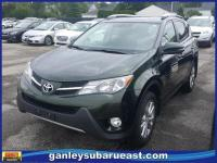 This beautiful one owner Spruce Mica Toyota RAV4