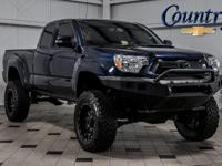 Tacoma... 4WD... Access Cab... 4.0 V6... 5-Speed