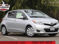 2013 Toyota Yaris Silver  37/30 Highway/City MPG