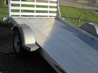 The bi-fold ramp provides a low profile while towing