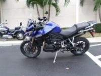 This is a gorgeous 2013 Triumph Tiger Explorer. This