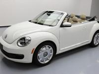 This awesome 2013 Volkswagen Beetle-New comes loaded