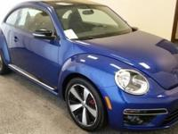 We just got in this 2013 Volkswagen Beetle Coupe 2.0T.