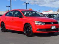 This 2013 Volkswagen Jetta comes with Black cloth