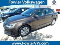 Jetta 2.5L SE and 6-Speed Automatic. Terrific fuel