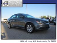 This 2013 VW Jetta is a four door midsize sedan. This