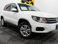 THIS TIGUAN COMES WITH 12 MONTHS/12,000 MILES OF VW