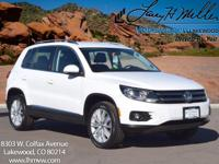 This turbocharged Candy White 2013 Volkswagen Tiguan