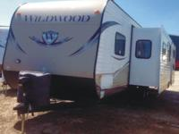 The pre-enjoyed 2013 Wildwood Travel Trailer