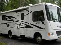 The Motorhome is equipped with a 14,800 BTU roof-mount